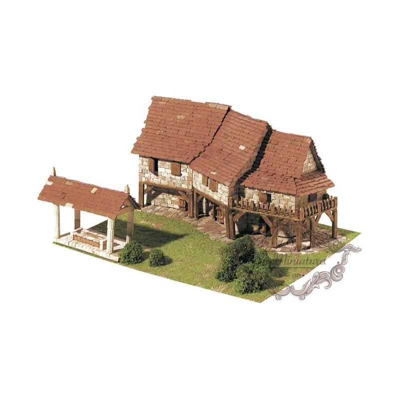 Brick model of cottages, 1412