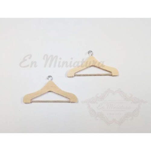 Two wooden hangers in miniature
