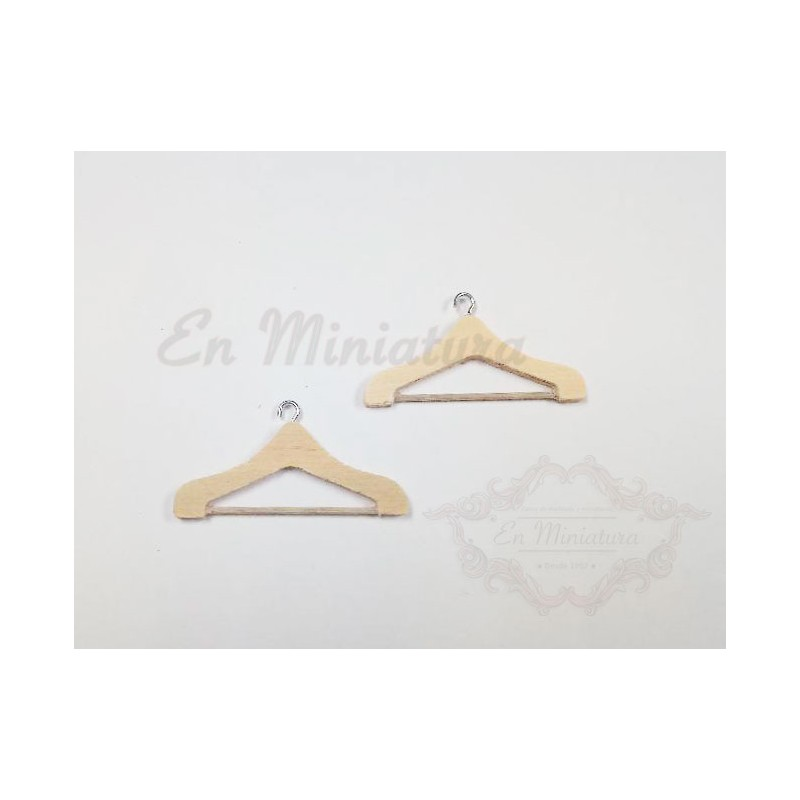 Two wooden hangers in miniature