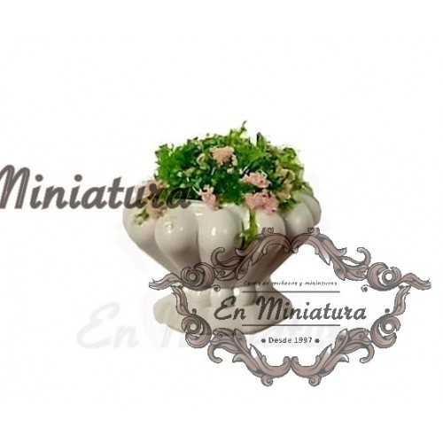 White planter with flowers