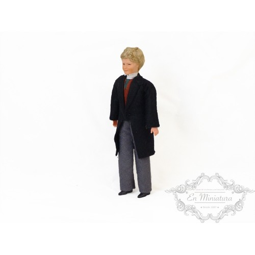 Doll with black coat