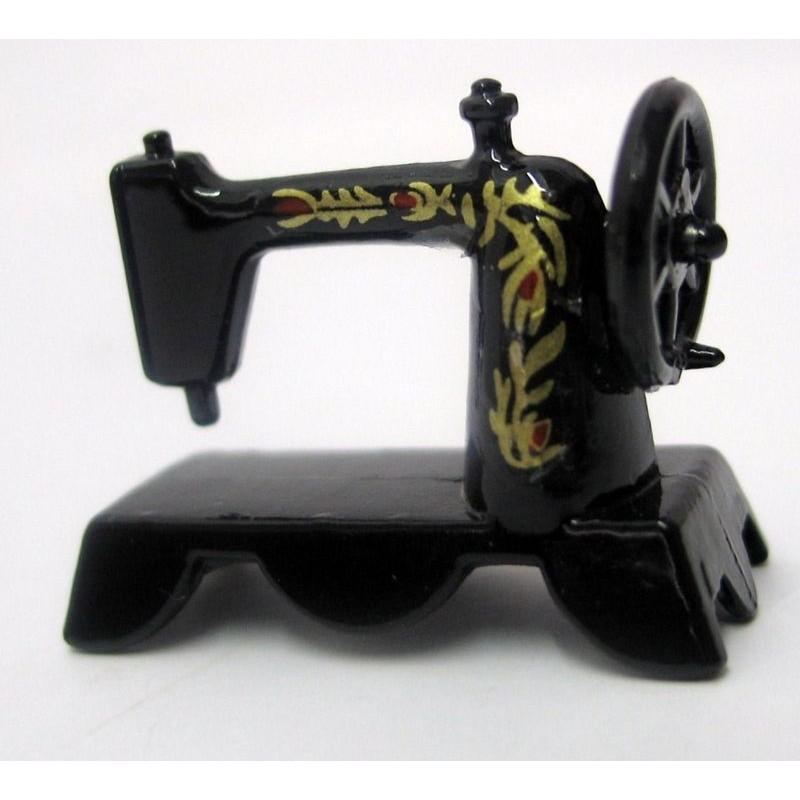 Máquina de coser en miniatura