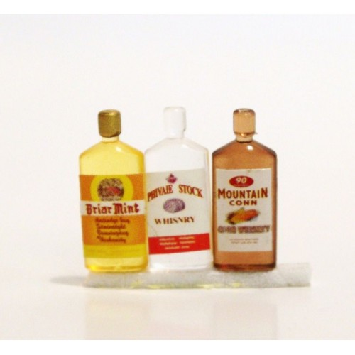 Botella de whisky plana