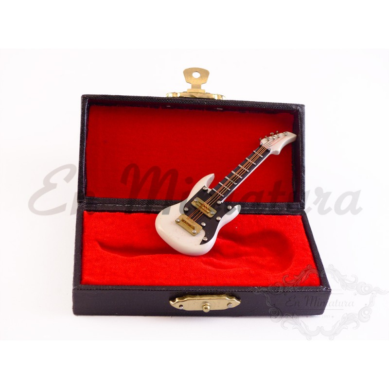 Guitarra eléctrica blanca con caja