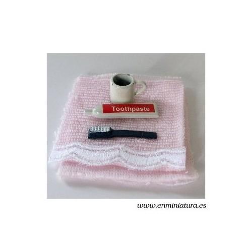 Toalla de baño con cepillo de dientes