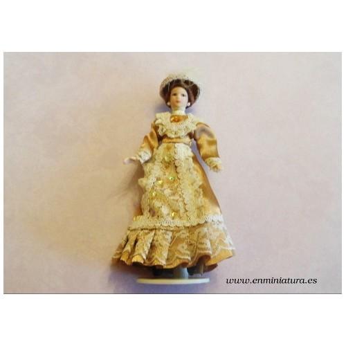 Muñeca victoriana dorada