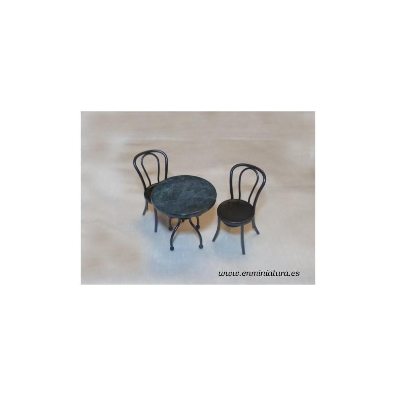 Mesa de mármol negra con sillas